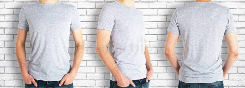 Män som bär den tomma gråa skjortan royaltyfria bilder
