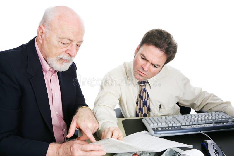 Män som gör skatter arkivbild