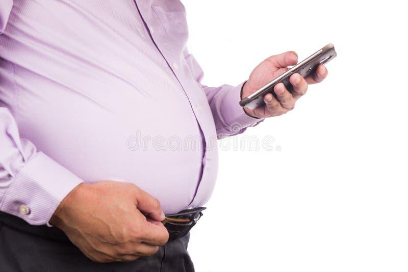 Män som klämmer den sjukliga stora magen med invärtes eller subkutant f royaltyfria foton