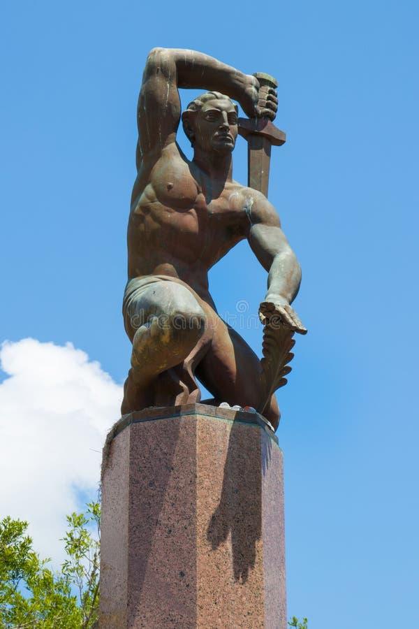 Männen, som denna monument står till, utfördes royaltyfria foton