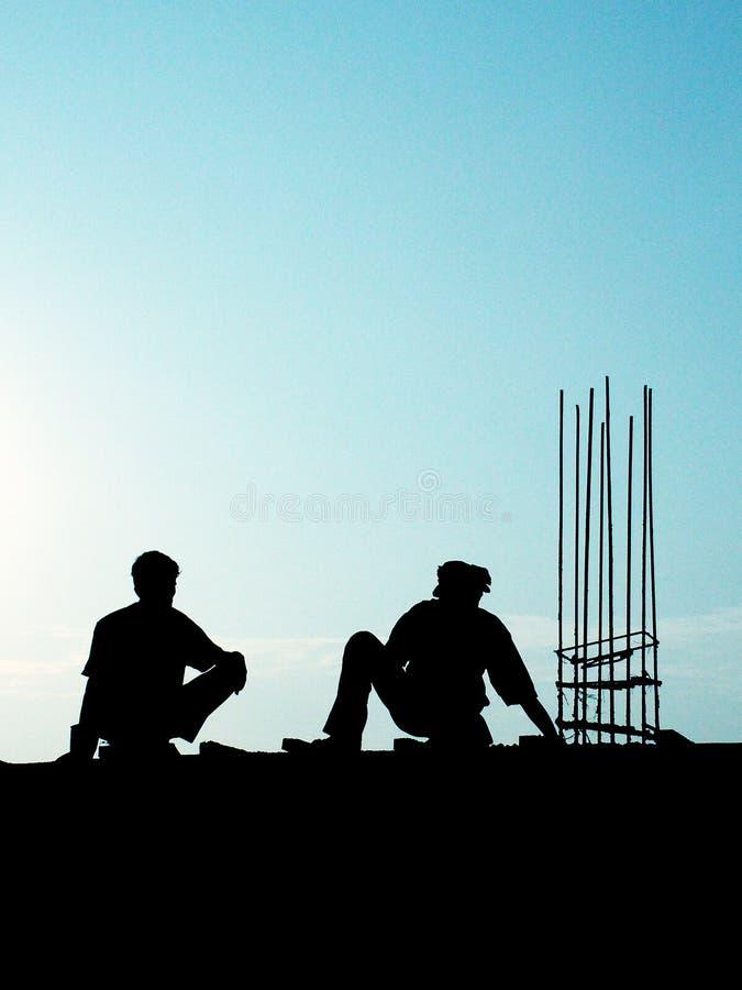 Männer bei der Arbeit lizenzfreie stockfotografie