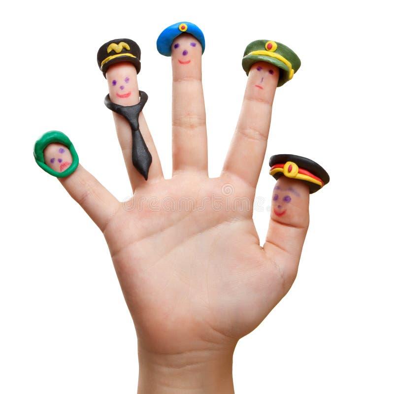 Männer gezeichnet auf die Finger mit Plasticinehutokkupationen lizenzfreies stockbild