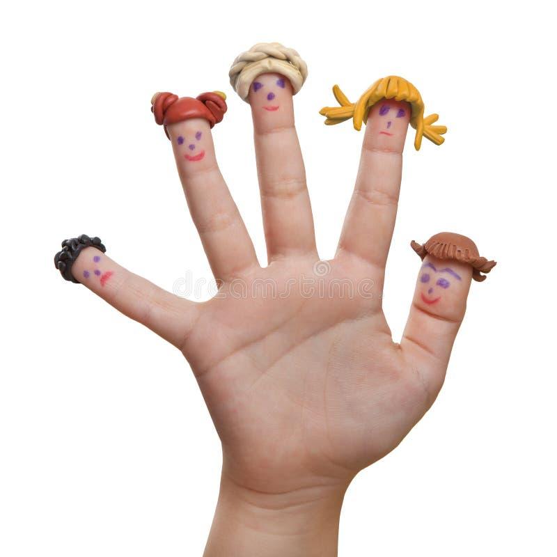 Männer gezeichnet auf die Finger mit Plasticineperücken lizenzfreie stockfotos