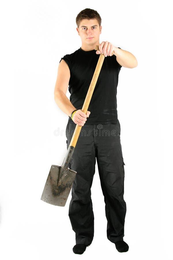 Männer im Schwarzen mit Schaufel stockbild