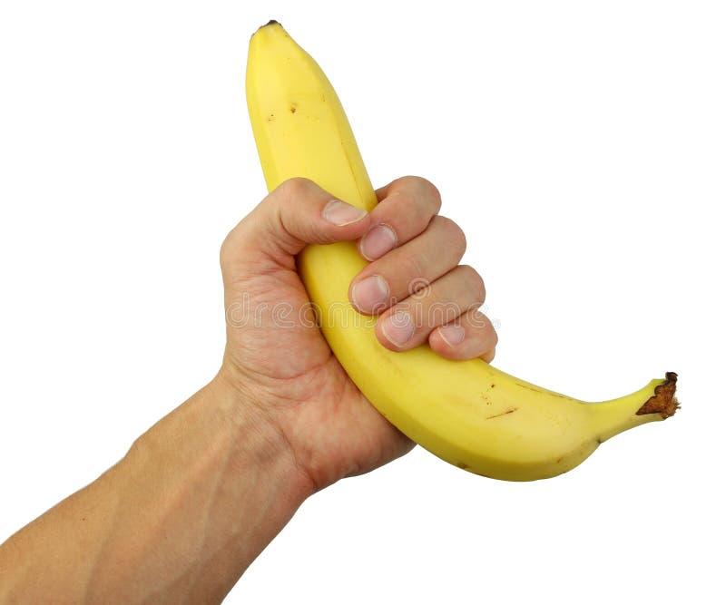 Människan räcker innehav en banan fotografering för bildbyråer