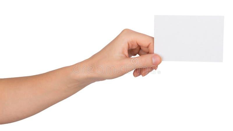 Människavänstersidahand med litet tomt papper royaltyfri bild