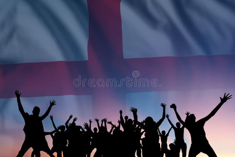Människor och flagga på Englands dag arkivbild
