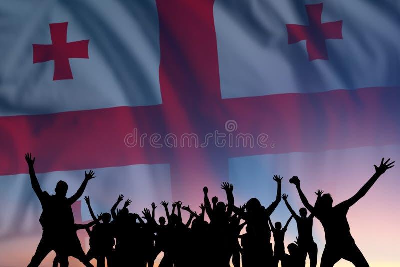 Människor och flagga på Georgiens dag royaltyfri bild
