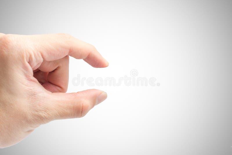 Männliche Handfinger-Auswahl oder Zupackenlagenahaufnahmeschuß lokalisiert lizenzfreies stockbild