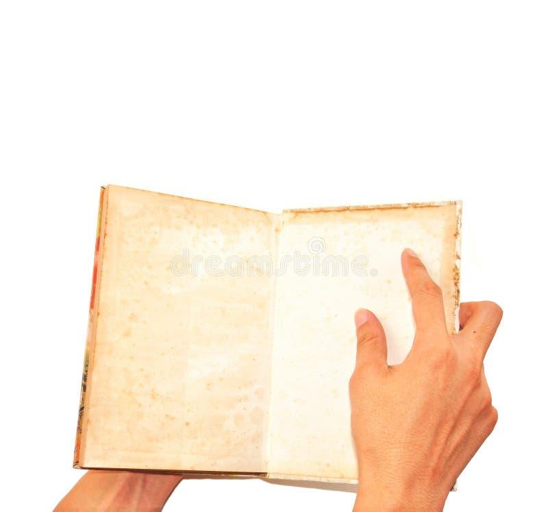 Männliche Handgeöffnetes grunge Buch getrennt auf Weiß stockfotos