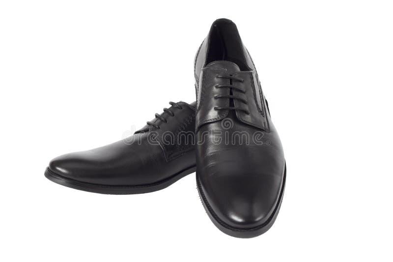 Männliche schwarze Schuhe getrennt auf dem weißen Hintergrund lizenzfreies stockfoto