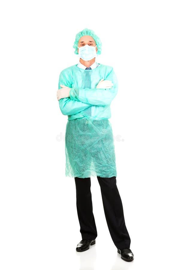 Männlicher Doktor mit Schutzkleidung stockbilder
