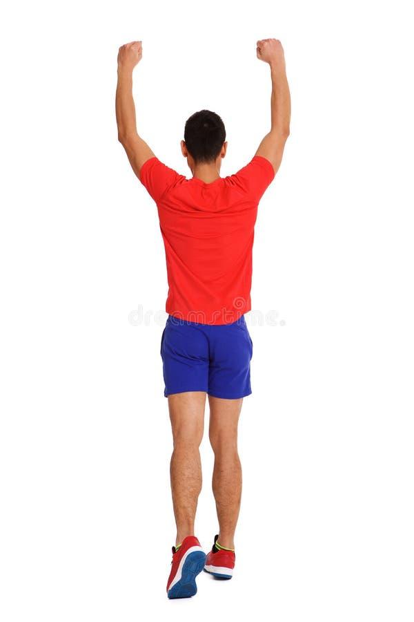 Männlicher Läufer, der das Rennen gewinnt stockbild