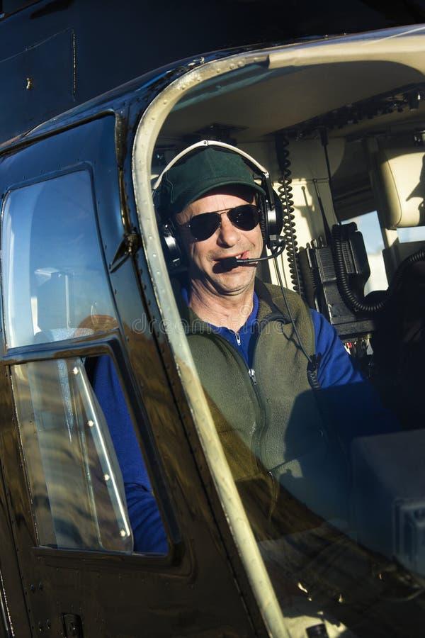 Download Männlicher Pilot Im Hubschrauber. Stockbild - Bild von sitting, niemand: 6150177