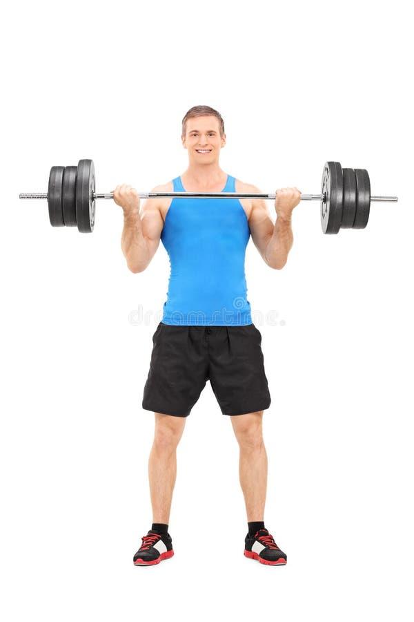 Männliches Bodybuilding, das einen Barbell anhebt lizenzfreies stockbild