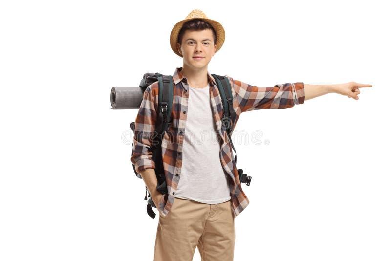 Männliches Jugendtouristenzeigen lizenzfreie stockfotos