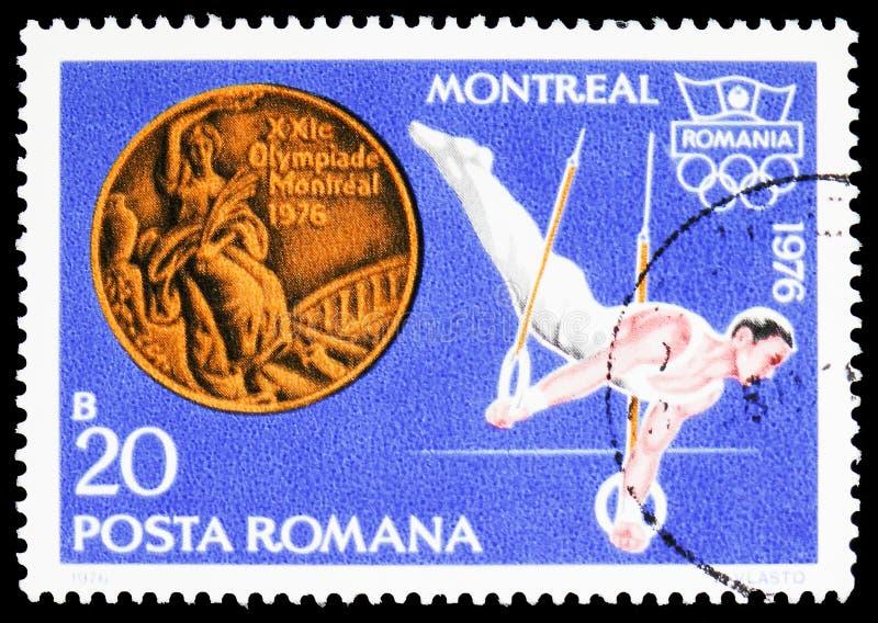 Mäns gymnastik (Dan Grecu) och bronsmedalj, sommarolympics 1976, Montreal - medaljserie, circa 1976 royaltyfria bilder