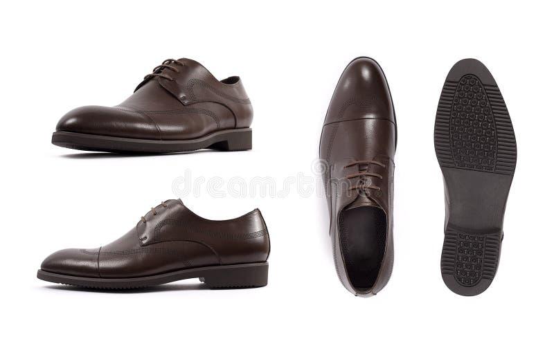 M?ns isolerade bruna skor, sko vit bakgrund Sidosikt, b?sta sikt och endast royaltyfri foto