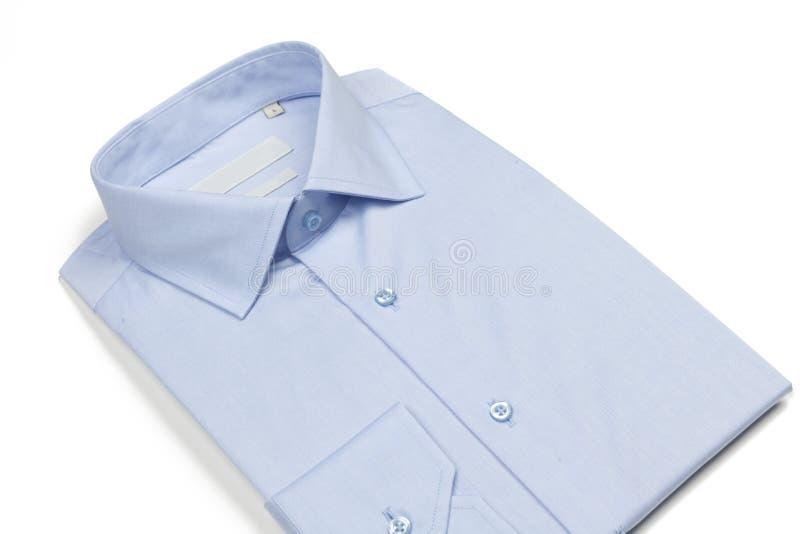 Mäns skjorta på vit bakgrund royaltyfri bild