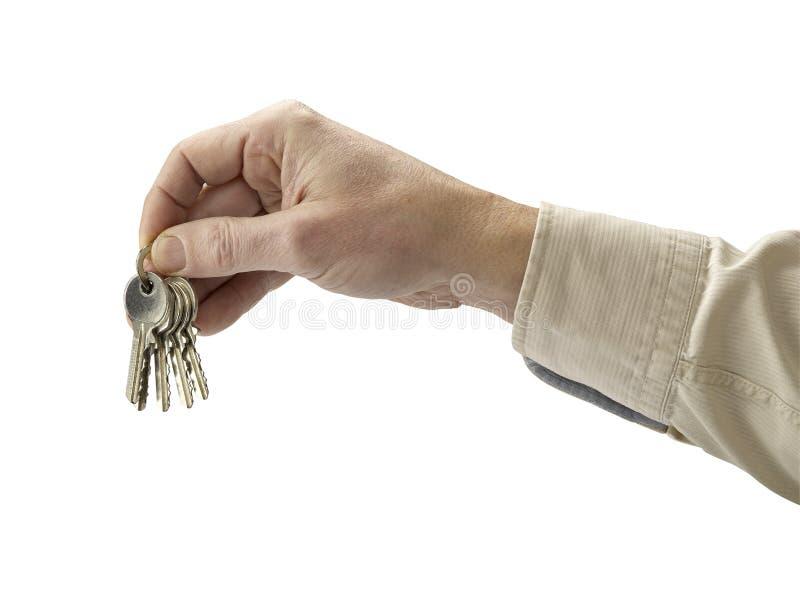 mänsklig isolerad key white för bakgrundshand royaltyfria foton