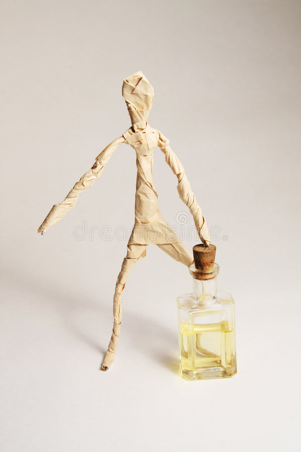 mänskligt oljepapper för flaska arkivfoto