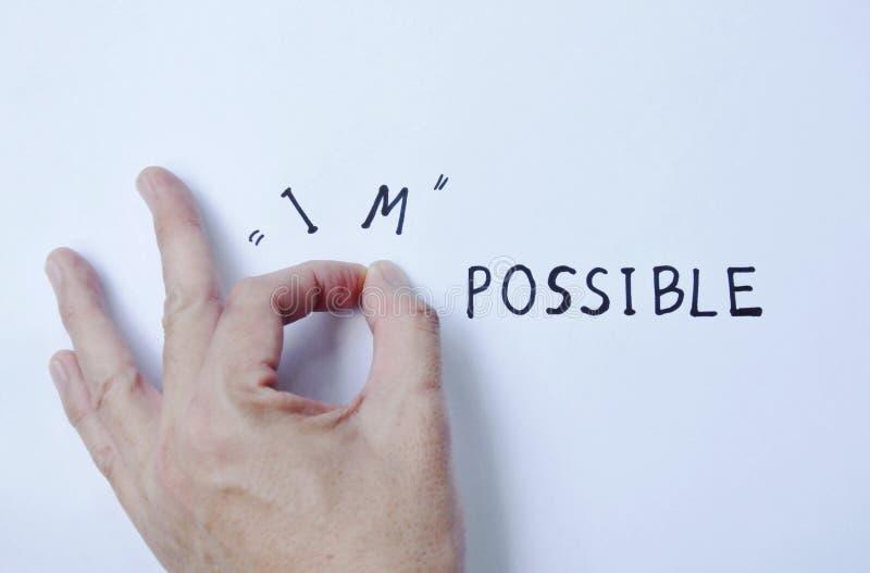 mänskligt peta för hand som är omöjligt till möjlighetord på vitbok arkivfoton