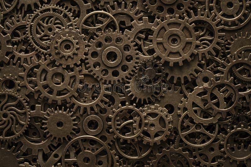 Mässingskuggehjul, steampunkbakgrund arkivfoton
