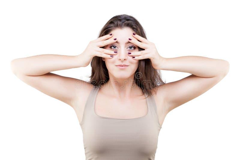 Młoda kobieta robi twarzy joga pozie obrazy stock