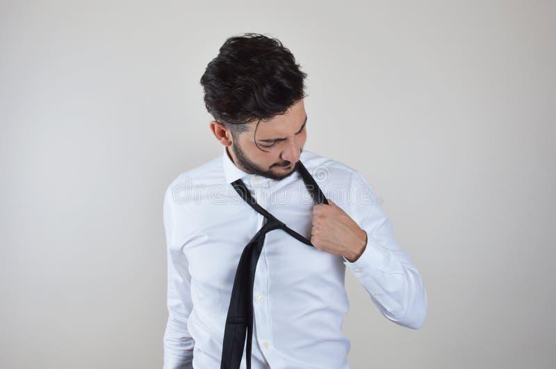 Młodego biznesmena emocjonalny stres i zanudzający zdjęcie royalty free
