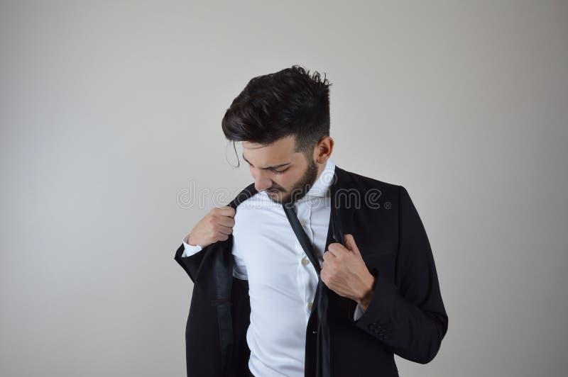 Młodego biznesmena emocjonalny stres i zanudzający obraz stock