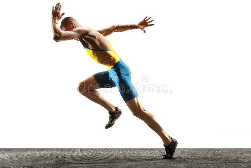Młody caucasian mężczyzny bieg, jogging odizolowywający na białym pracownianym tle lub zdjęcie stock