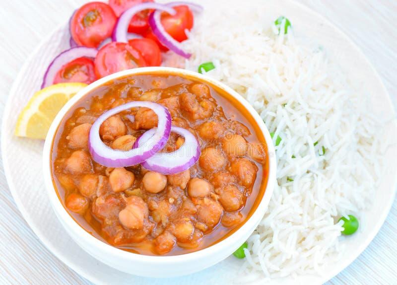 Mål för ris för masala för Chole chawal-Punjabi channa royaltyfri bild