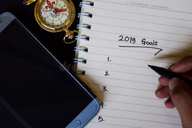 2019 mål smsar på anteckningsboken arkivfoton