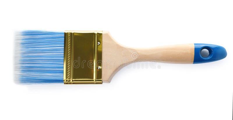 Måla borsten med det blåa borstet på vit royaltyfri fotografi