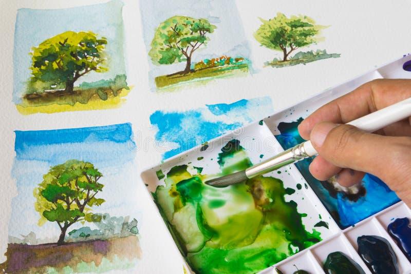Måla trädet med vattenfärgen arkivfoto