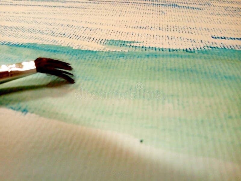 Måla vattenfärgen på kanfaspapper royaltyfri foto