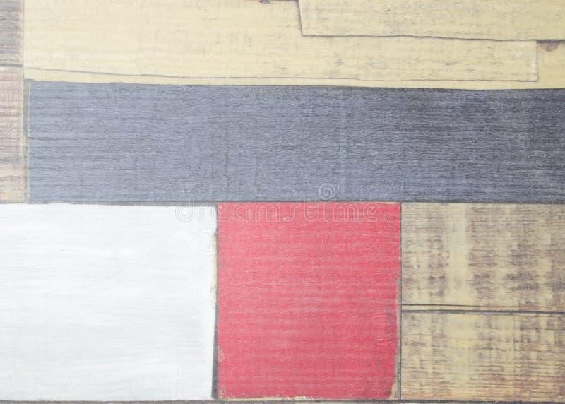 Målad fauxparkett som kulöra plankor arkivfoton