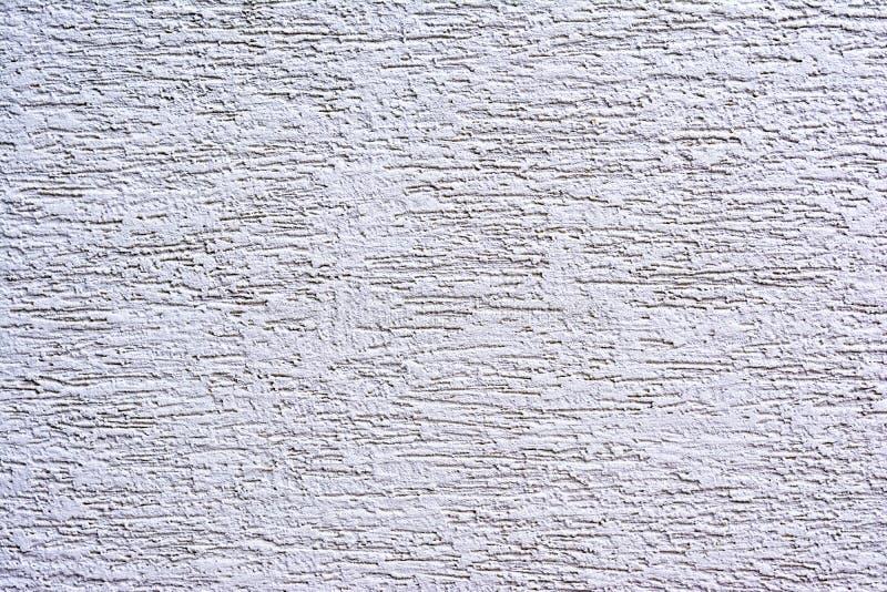 Målad vägg med det grova texturcloseupfotoet royaltyfri foto
