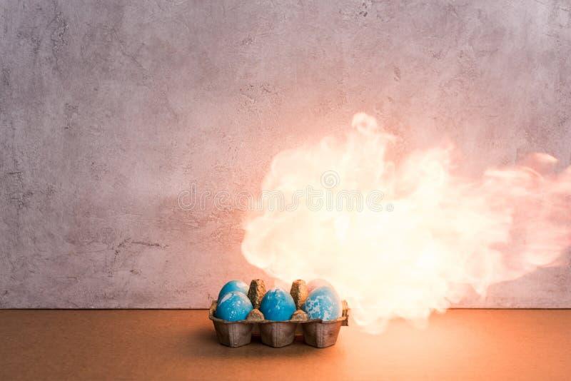 Målade ägg på brand royaltyfri fotografi