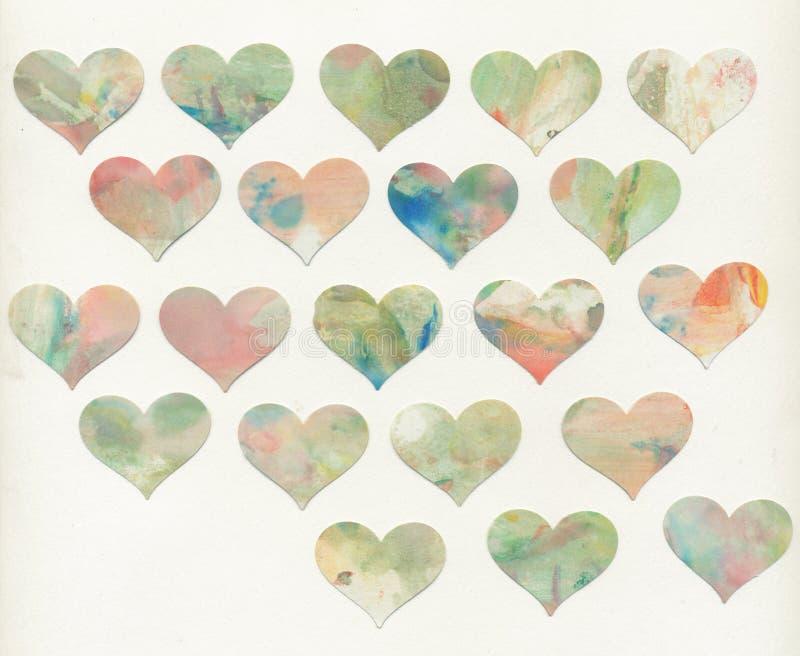 Målade hjärtor med vitbakgrund royaltyfri bild