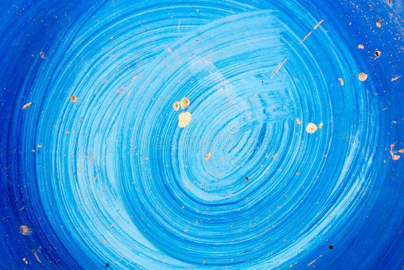 Målade konstnärligt abstrakt begrepp för blå färg skrapan på gammal cementtextu arkivfoton