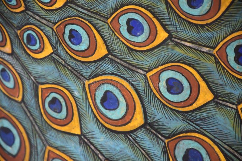 Målade påfågelfjädrar royaltyfri foto