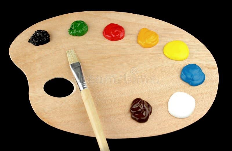 Målarfärgborstar, färger och palett royaltyfri bild