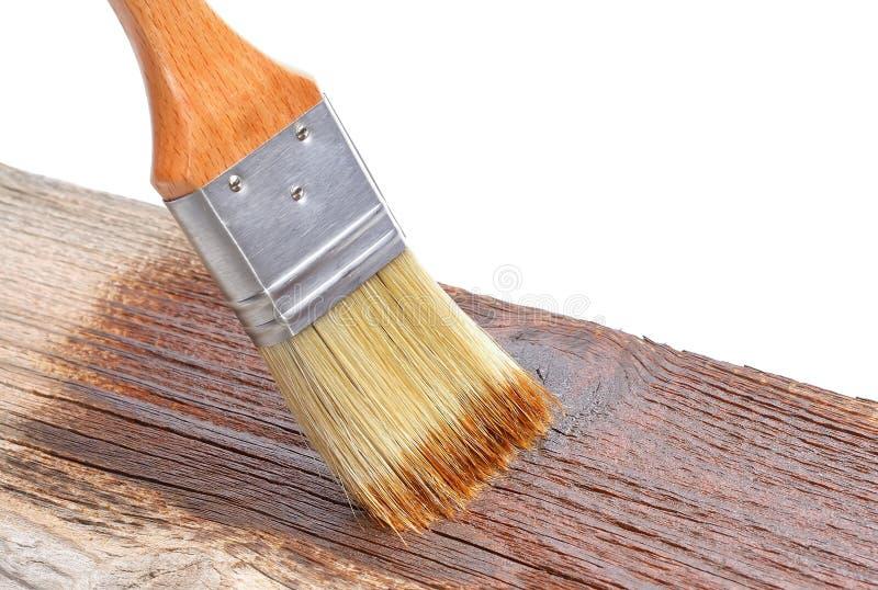 Målarfärgborste på trä royaltyfri bild