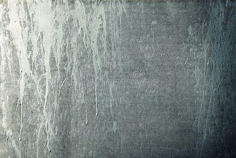 Målarfärgstrimmor på en grungekanfas arkivfoton