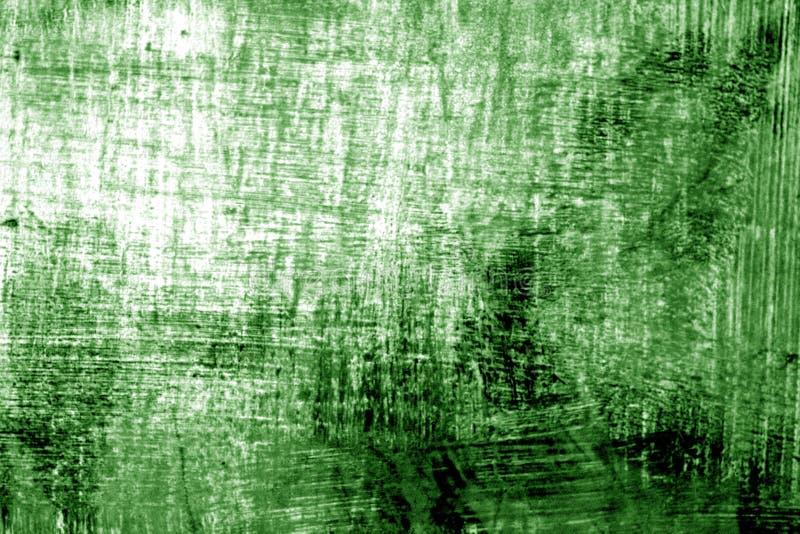 Målarfärgstrockes på metall i grön signal arkivfoton