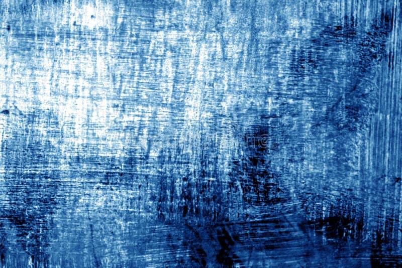 Målarfärgstrockes på metall i marinblå signal royaltyfri fotografi