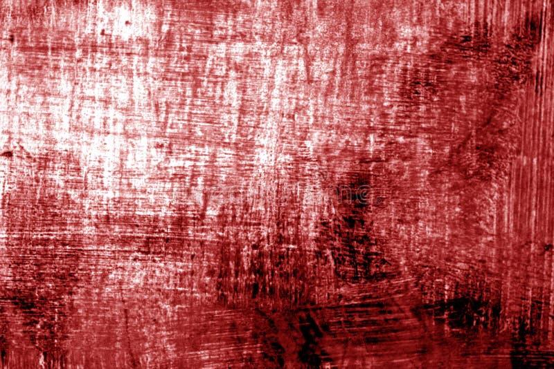 Målarfärgstrockes på metall i röd signal arkivbild