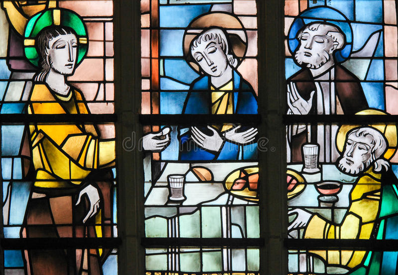 Målat glass - Jesus på den sista kvällsmålet arkivfoton