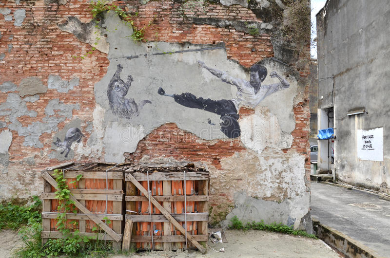 Målning av en vägg- målning för gata 'den verkliga Bruce Lee Would Never Do This', arkivfoton
